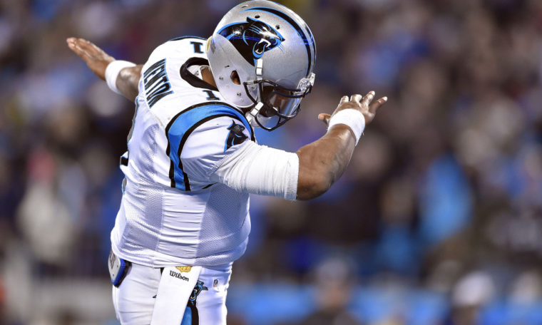 Jan 24, 2016; Charlotte, NC, USA; Carolina Panthers quarterback Cam Newton (1) celebrates after scoring a touchdown during the second quarter against the Arizona Cardinals in the NFC Championship football game at Bank of America Stadium. Mandatory Credit: Bob Donnan-USA TODAY Sports